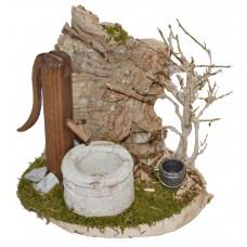 Brunnen mit Kork und Busch
